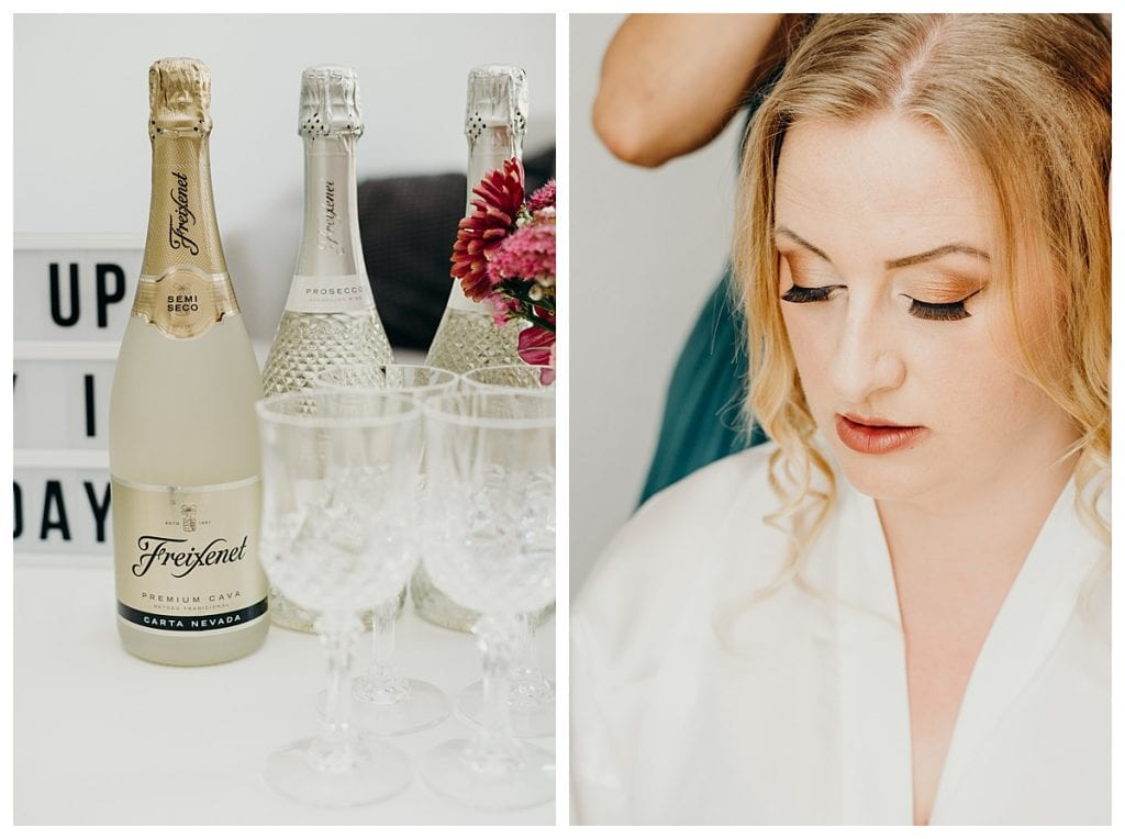 close up on bride's makeup and wine glasses before her bern Switzerland wedding