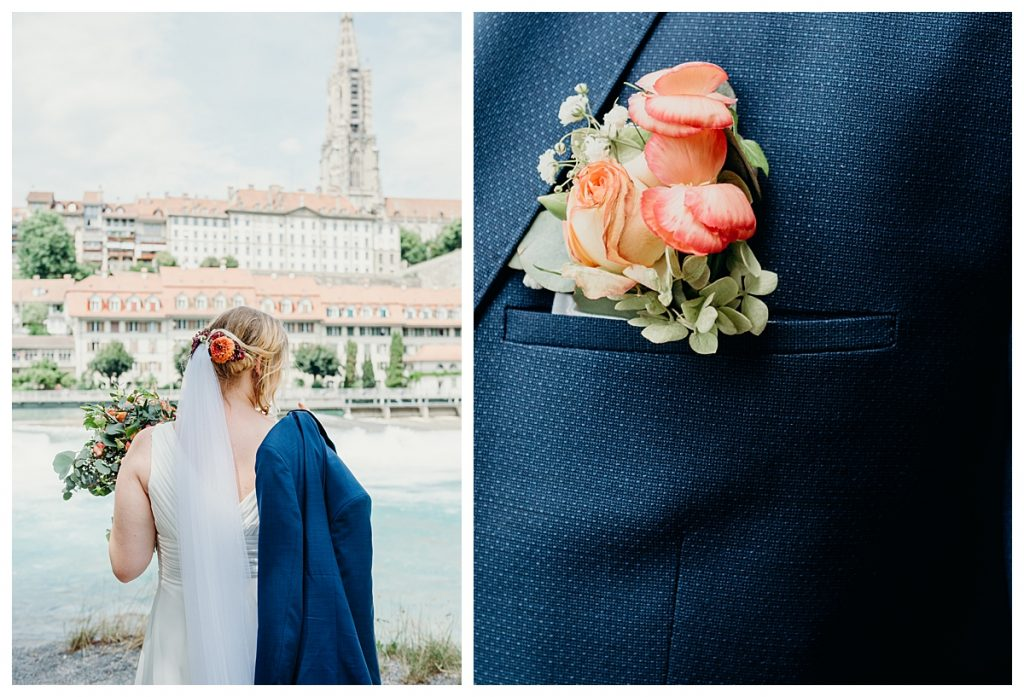 bride holding groom's jacket in front of Bern Minster and close up of groom's boutonniere