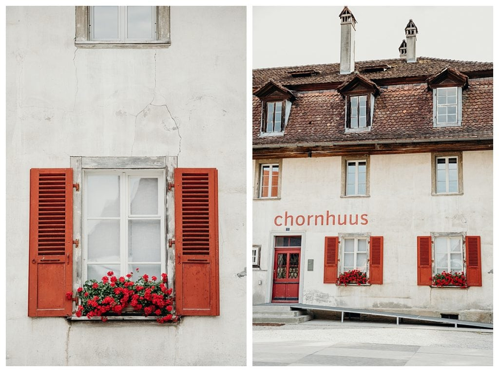 red shutter and flower boxes at the Kulturhof Schloss Köniz in bern Switzerland