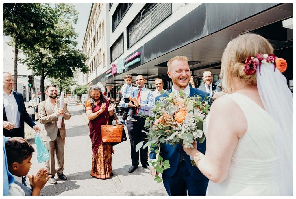 groom looking at bride smiling after their wedding in Bern Switzerland