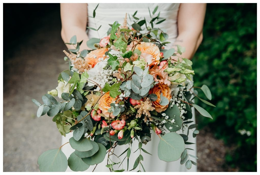 close up green and orange wedding bouquet in Bern Switzerland