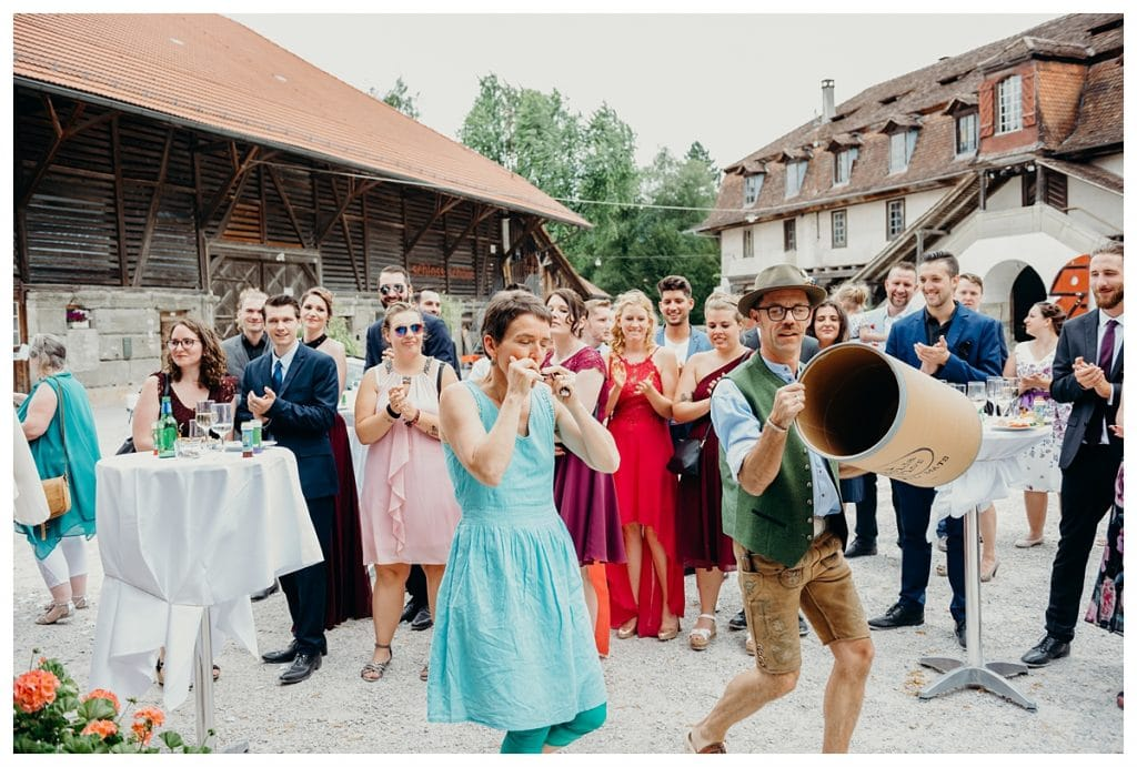 traditional Swiss musicians play authentic music at Kulturhof Schloss Köniz wedding reception in Bern Switzerland
