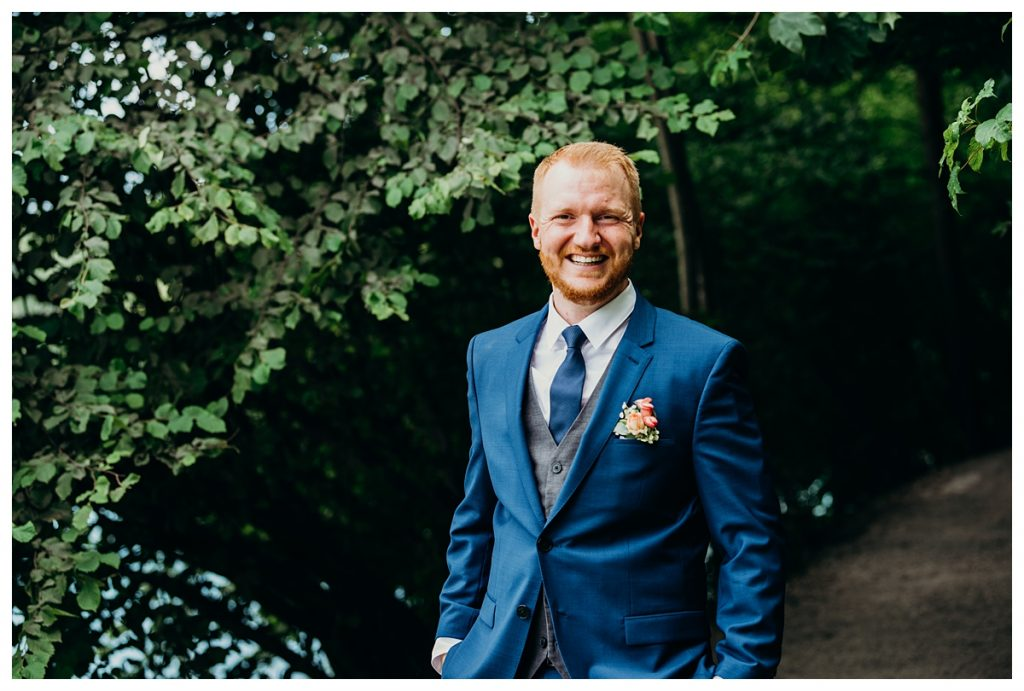 groom smiling in suit after his Bern Switzerland wedding