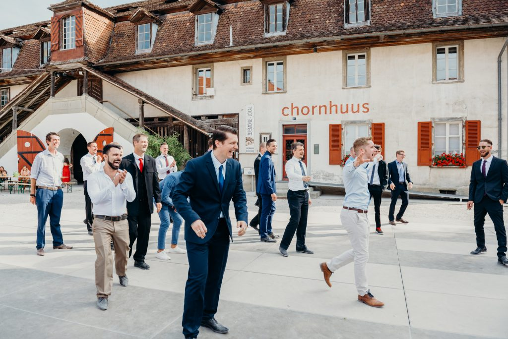 guy catches garter during the castle koniz wedding reception in Bern Switzerland