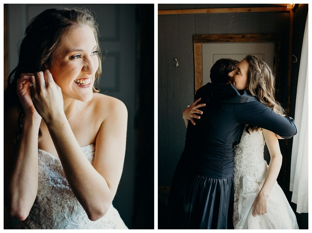 bride putting earrings on and hugging her mom before her winter wedding at Firefly Lane