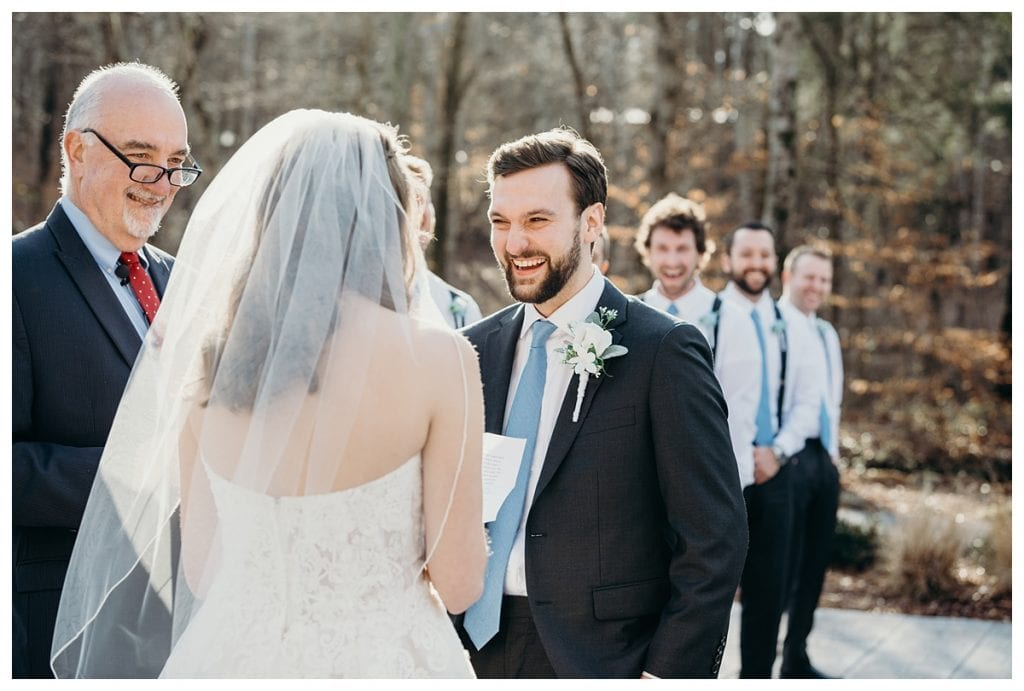 groom laughing during their exchange of vows at their Firefly Lane wedding