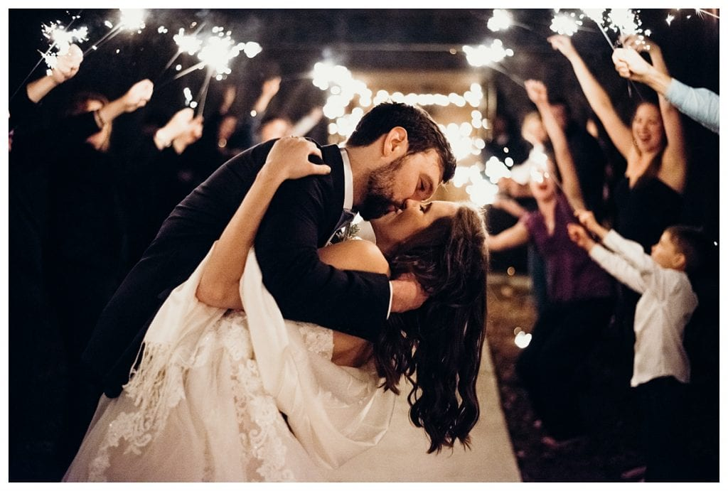 bride and groom kiss during the sparkler exit at Firefly Lane wedding venue in Dickson Tennessee