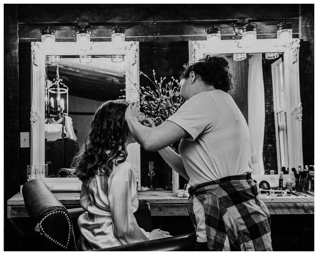bride getting her makeup done before her winter Firefly Lane wedding