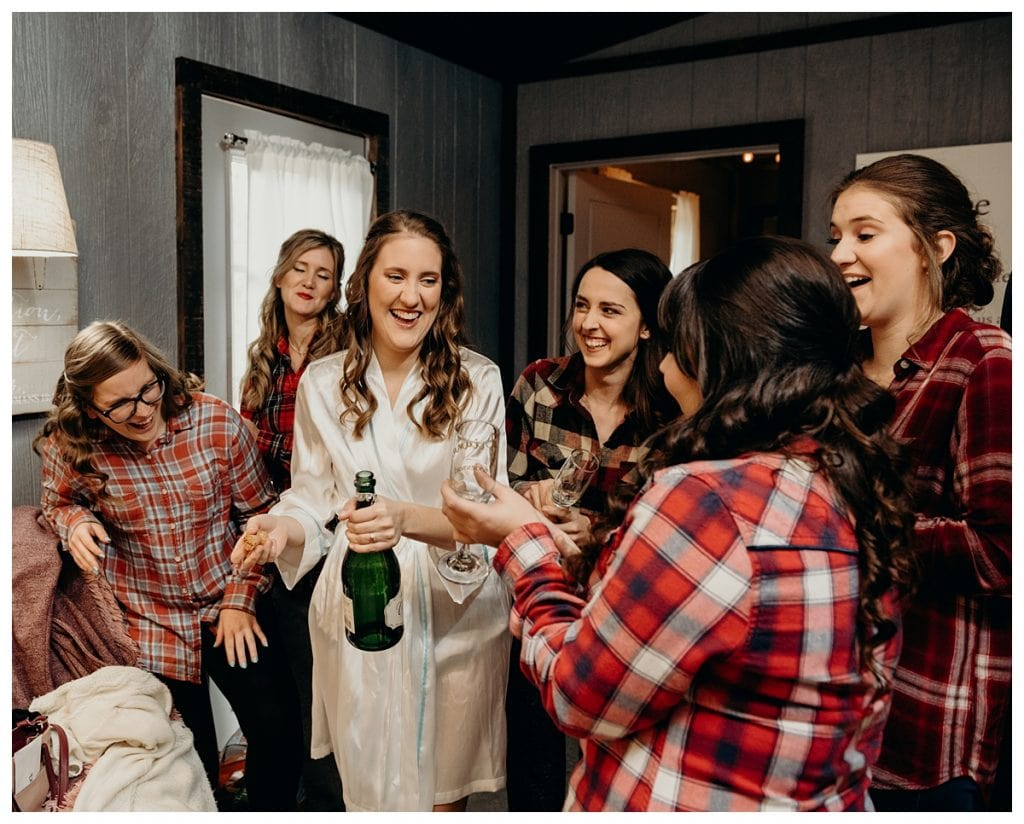 Bride holding champagne with bridesmaids at Firefly Lane in Dickson Tennessee