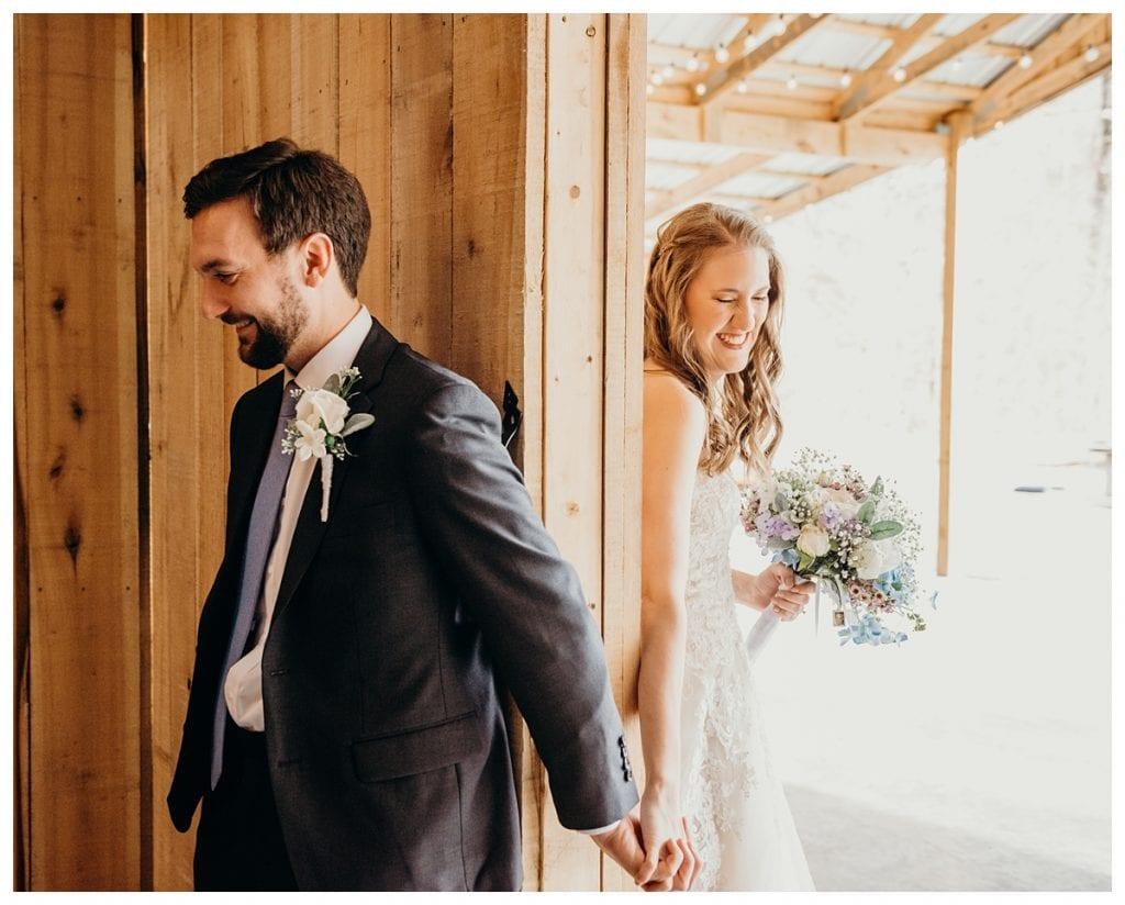 bride and groom in between walls pray before their winter Tennessee wedding