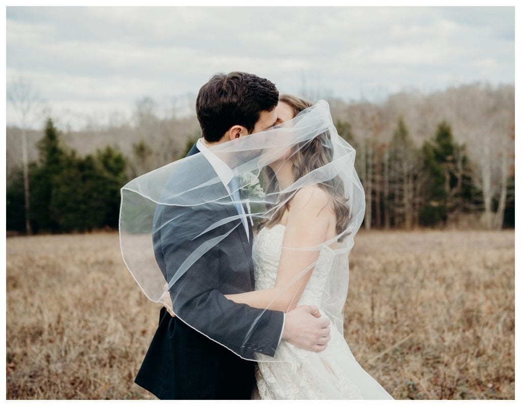 veil blowing against bride and groom during their Firefly Lane wedding in Dickson Tennessee