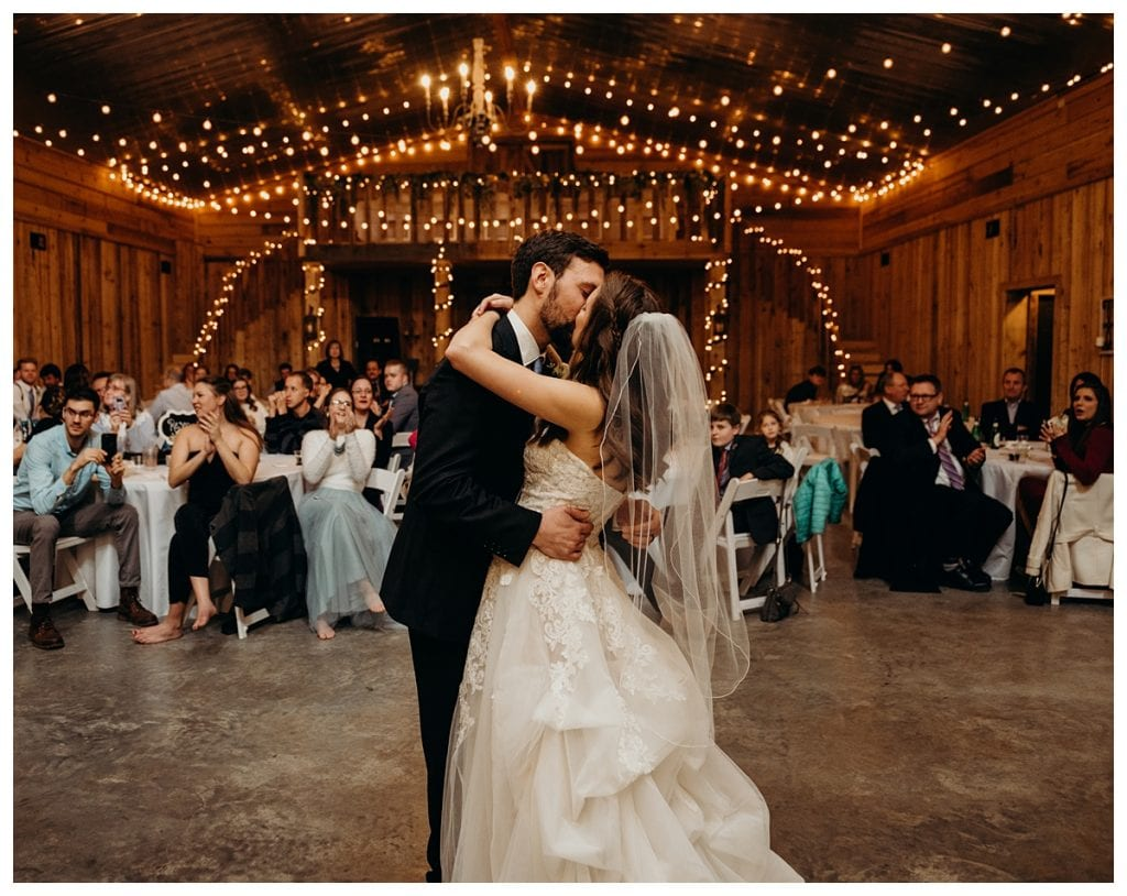 bride and groom kiss during their first dance at Firefly Lane wedding venue