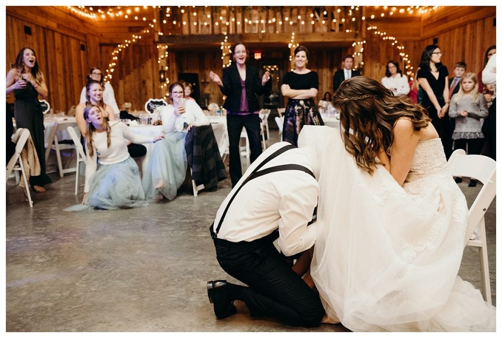 groom gets bustle under bride's dress at Firefly Lane in Dickson Tennessee