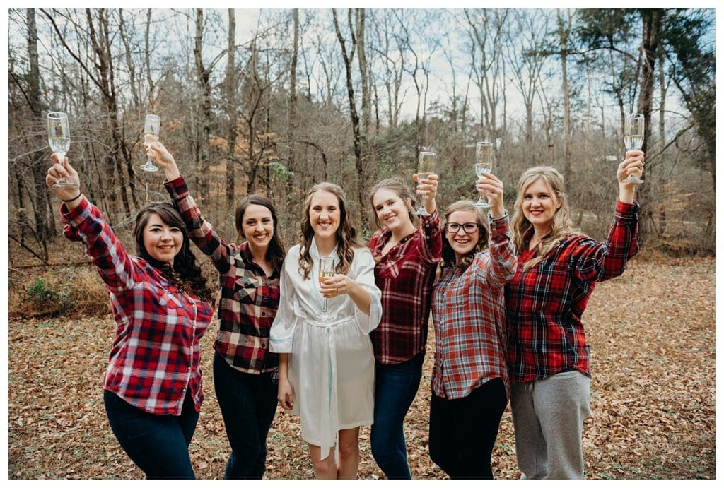 bride and bridesmaids raising champagne glasses at Firefly Lane in Dickson